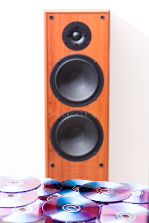 CD, discos do dvd com orador audio fotografia de stock
