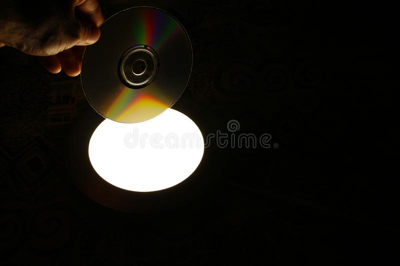 CD disk in hand. Optical digital disc in hand royalty free stock image