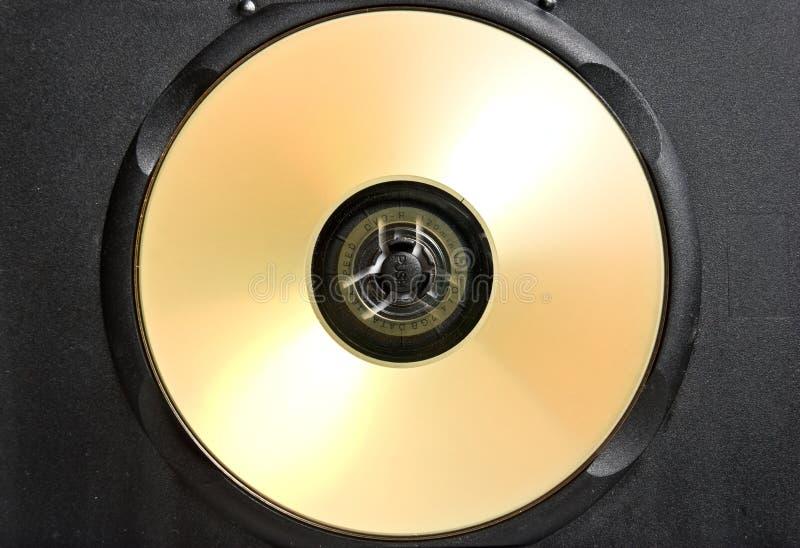CD do ouro na caixa preta fotografia de stock royalty free