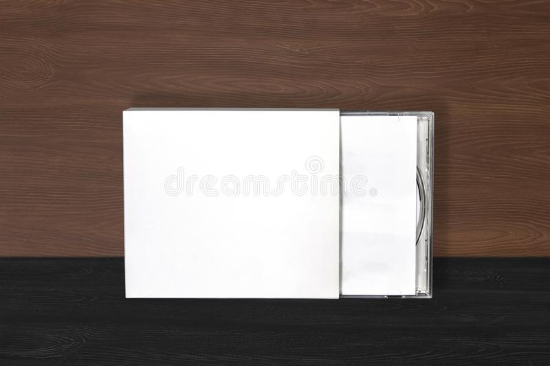 Cd dvd cover album design template mockup on wood background for musician stock image