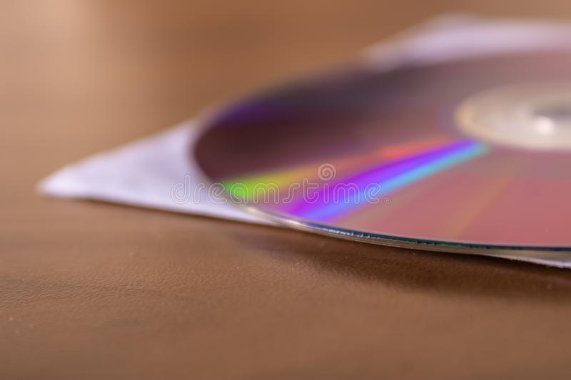 CD DVD disc on the wooden table, old compact disc - Image stock photo