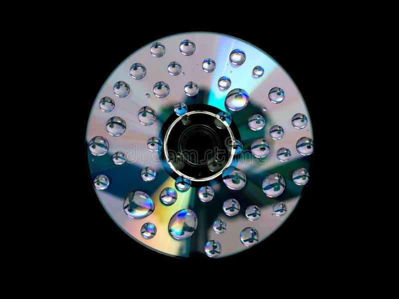 CD DVD-diskett med vattendroppar royaltyfria bilder