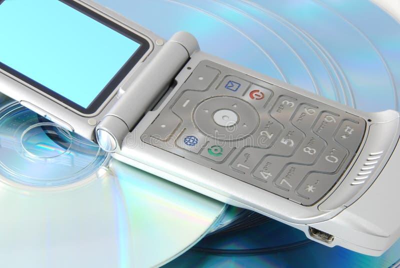 Cd e um telefone de pilha fotografia de stock