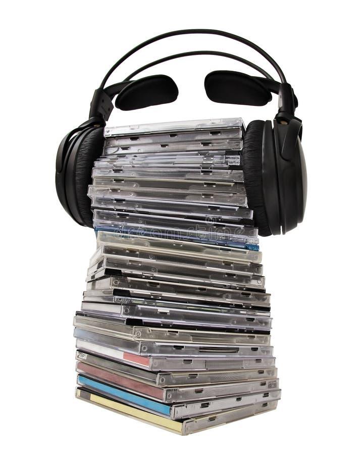 cd hörlurarhög royaltyfria bilder