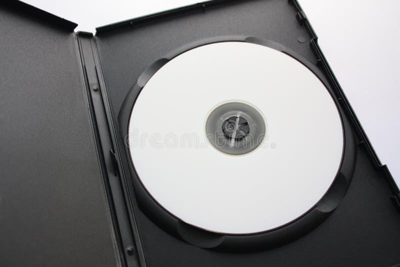 CD oder DVD im schwarzen Kasten lizenzfreie stockbilder