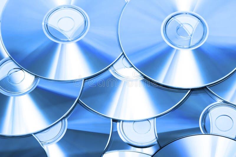Cd ou romes de DVD para o fundo imagens de stock royalty free