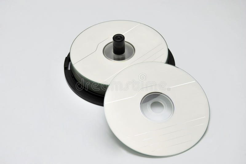 CD rom. Some cd rom stacked over a white background stock images