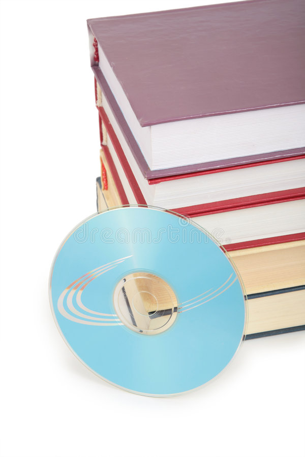 Cd-rom disk and pile of books. On a white stock images