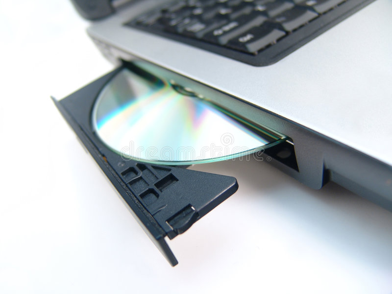 CD-ROM drive with CD. Over white background stock image