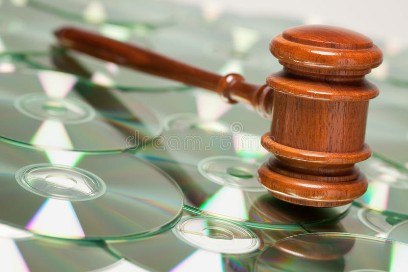 CD ROM or DVD Discs and Gavel. CD Rom or DVD Discs Spread Out and Gavel stock photography