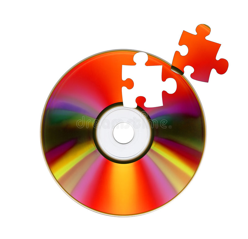 CD-ROM e puzzle. fotografia stock