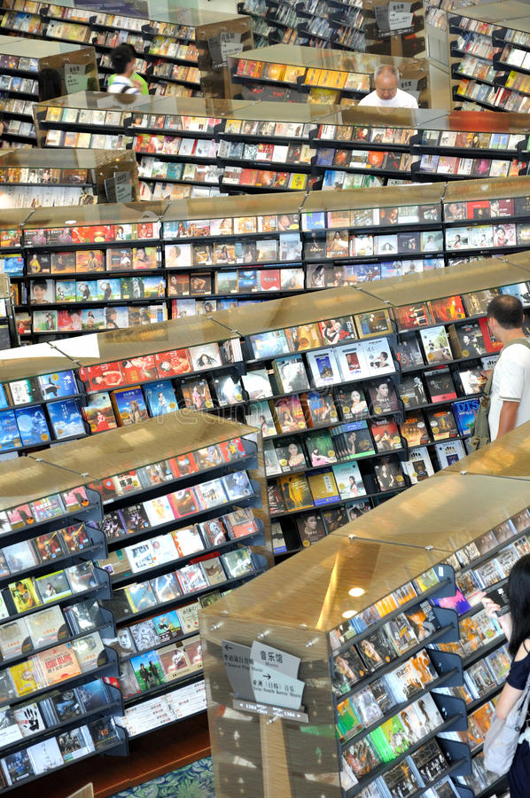 CD store. Part of CD store interior, in Guangzhou city, China, shown as CD selling business and people buying for living entertainment or culture life royalty free stock image