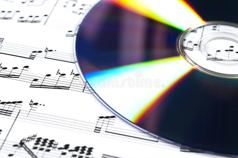 Cd und musikalische Kerbe lizenzfreie stockfotos