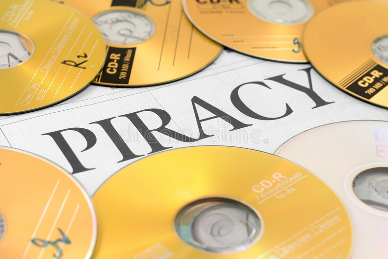 Cd and word of piracy stock image