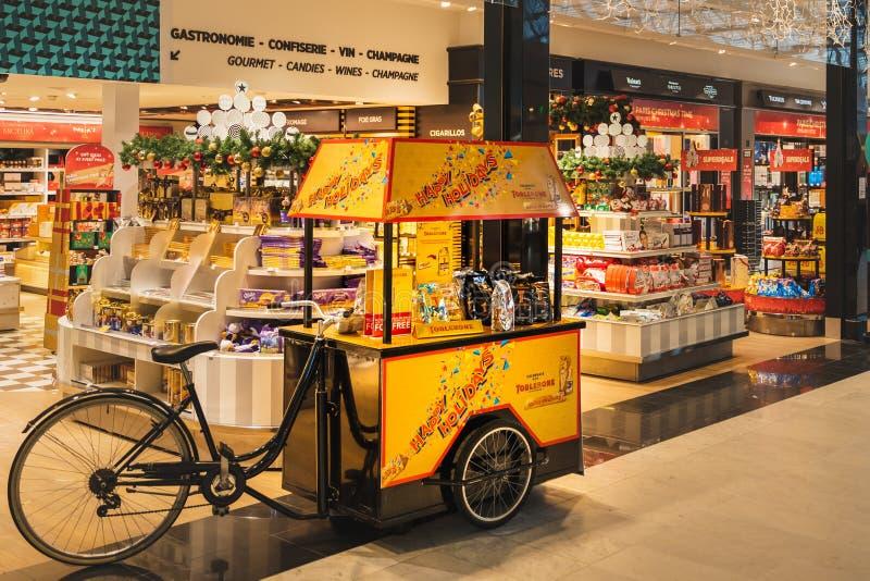 CDG Airport, Paris - 12/22/18: Toblerone promo stand in sweets shop at airport. CDG Airport, Paris - 12/22/18: Toblerone promo stand in sweets shop at Paris stock photography