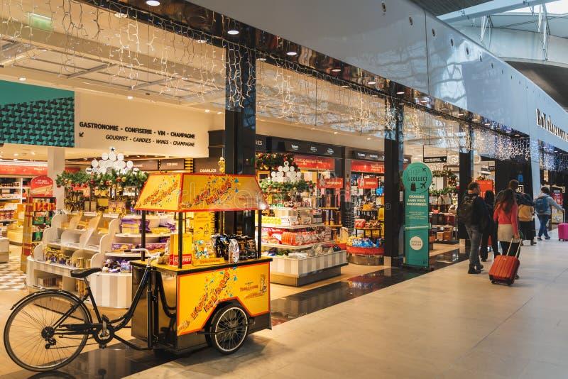 CDG Airport, Paris - 12/22/18: Toblerone promo stand in sweets shop at airport. CDG Airport, Paris - 12/22/18: Toblerone promo stand in sweets shop at Paris stock image