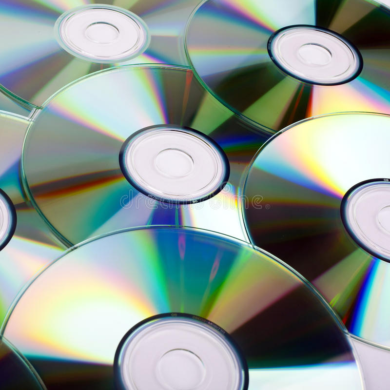CDs. (Compact Discs) laid out on a white background royalty free stock images