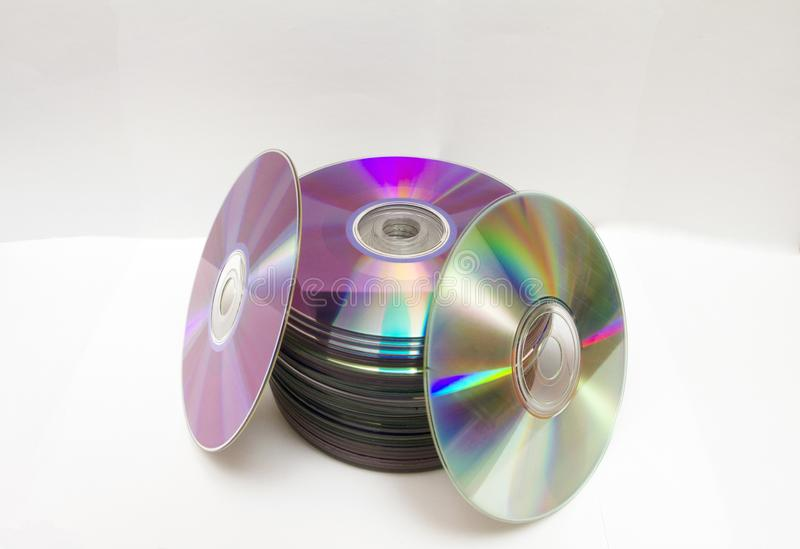 The CDs are arranged on a white background.. royalty free stock photography