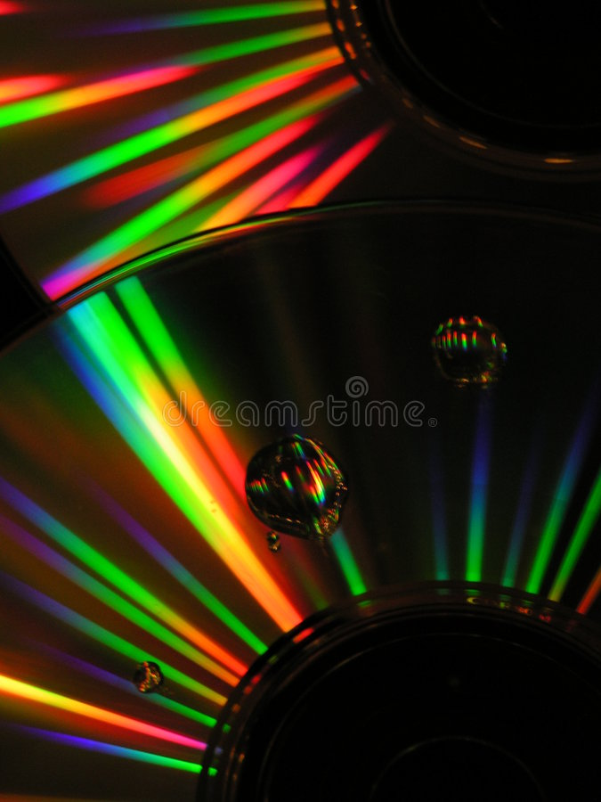 Cds with drops of water royalty free stock image