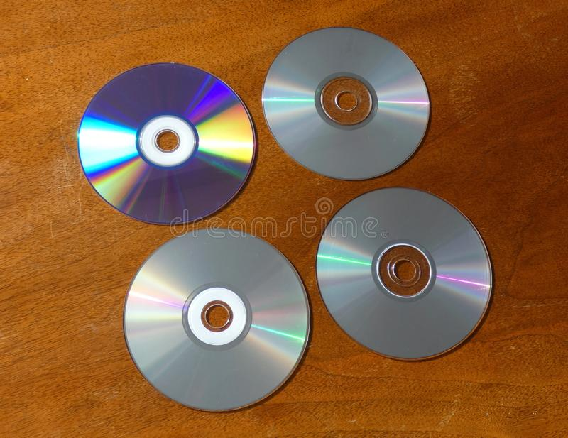 CDs Empty and Full 4 Compact Discs. Format, kind of digital optical disc data storage. Memory device for computer. How to recognize used CD stock images