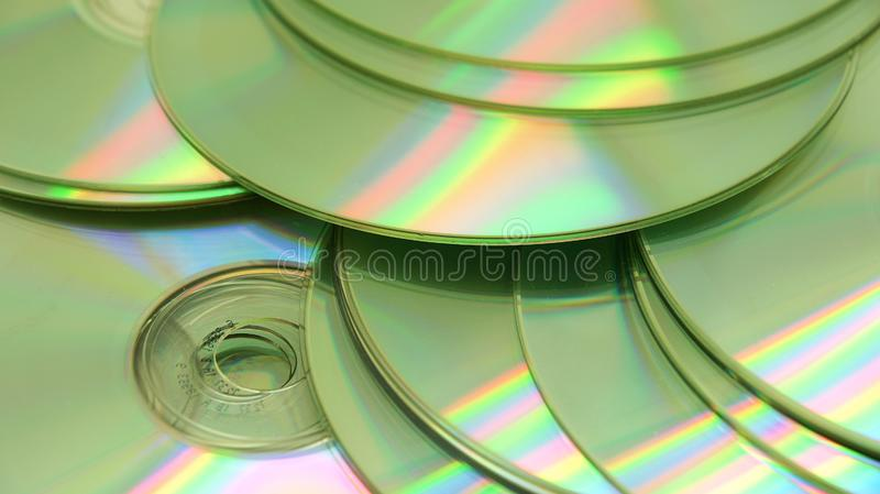 CDs on white background stock images
