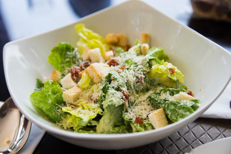 Ceasar salad with bacon bits. A delicous appetizer of bacon bits and ceasar salad royalty free stock photo
