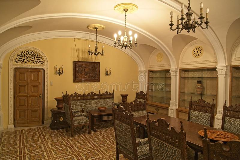The Ceausescu Palace Dinning. BUCHAREST, ROMANIA - MARCH 7, 2017: The Ceausescu Palace or sometimes called The Ceausescu Mansion or Spring Palace.  Was restored royalty free stock photography