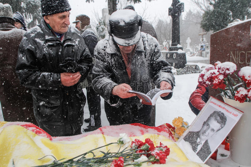 Ceausescu`s commemoration. Bucharest, Romania, January 26, 2014: People gathered at the grave of Romania`s late communist dictator Nicolae Ceausescu, to stock image