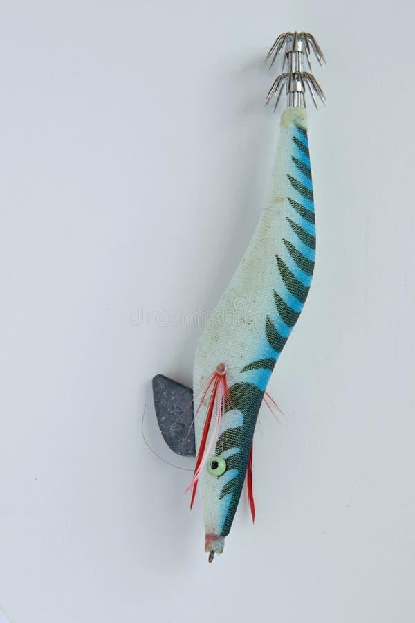 cebo de pesca plástico colorido en el fondo blanco, espacio para el texto foto de archivo