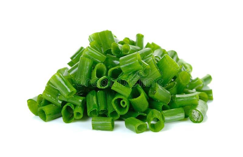Cebola verde cortada isolada no fundo branco fotografia de stock royalty free