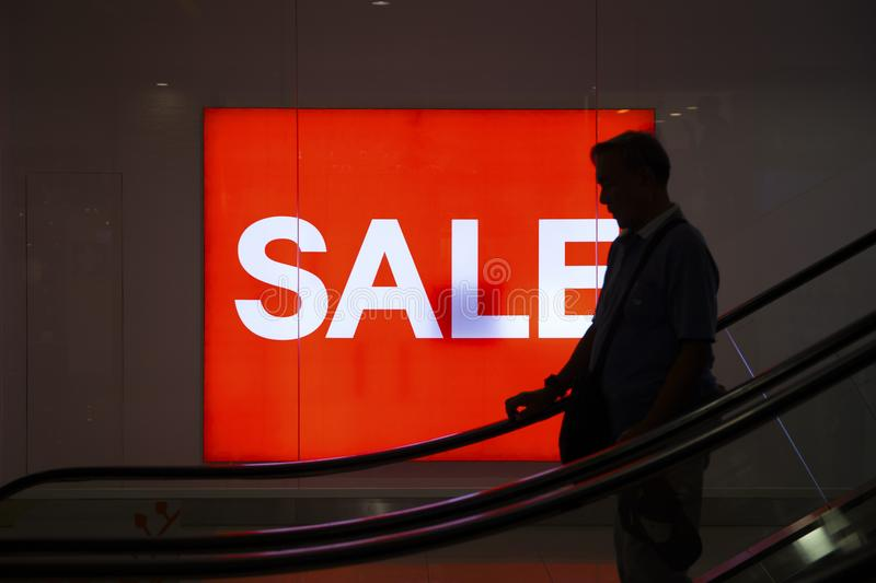 Cebu, the Philippines - March 22, 2018: red banner Sale and shopper silhouette. Black Friday banner in shopping mall. Cebu City, the Philippines - March 22, 2018 stock image