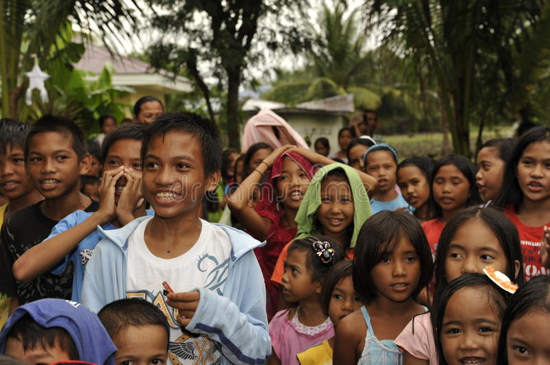 CEBU - PHILIPPINES - JANUARY,1 2013 - Annual orphan children party. They receive food and gifts royalty free stock image