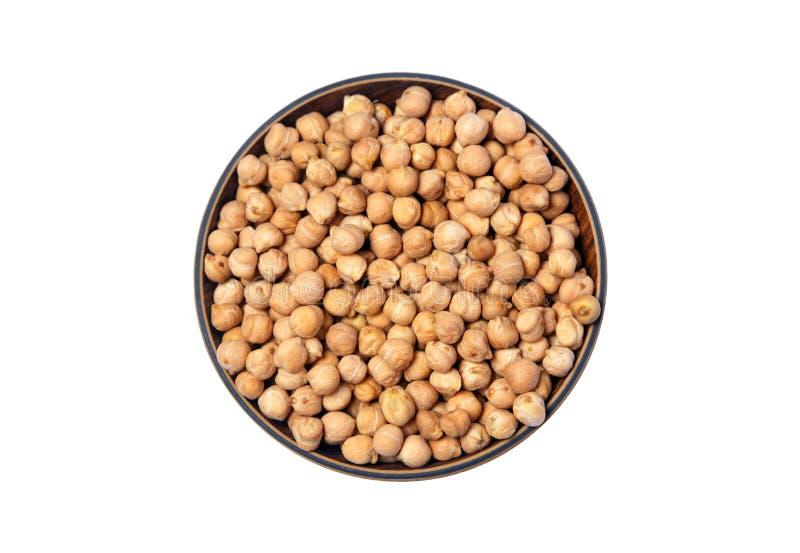 Ceci bianchi secchi, Chana bianco, fagioli pakistani/indiani delle lenticchie secche del cece, in ciotola di legno isolata su fon immagini stock libere da diritti