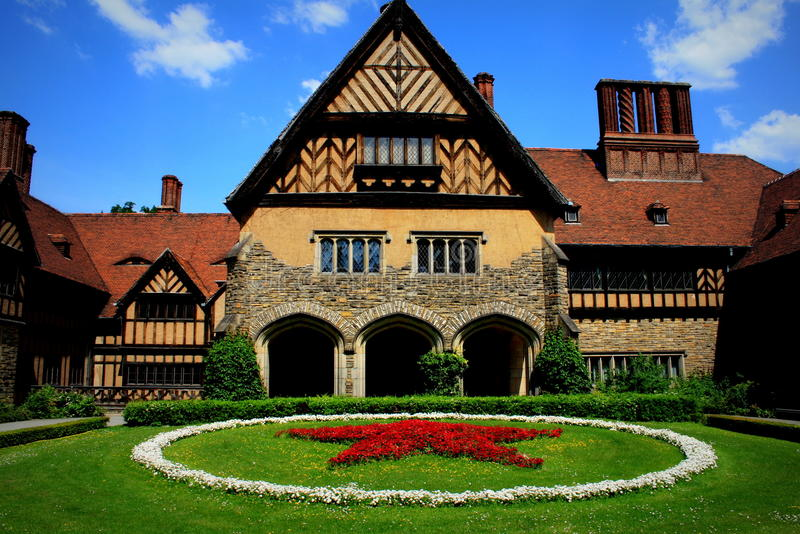 Cecilienhof. The Cecilienhof Palace is a palace located in the northern part of the Neuer Garten park in Potsdam, close to lake Jungfernsee. Since 1990 is part royalty free stock photos