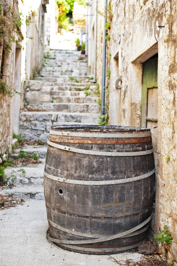 Cedar barrel in a narrow street