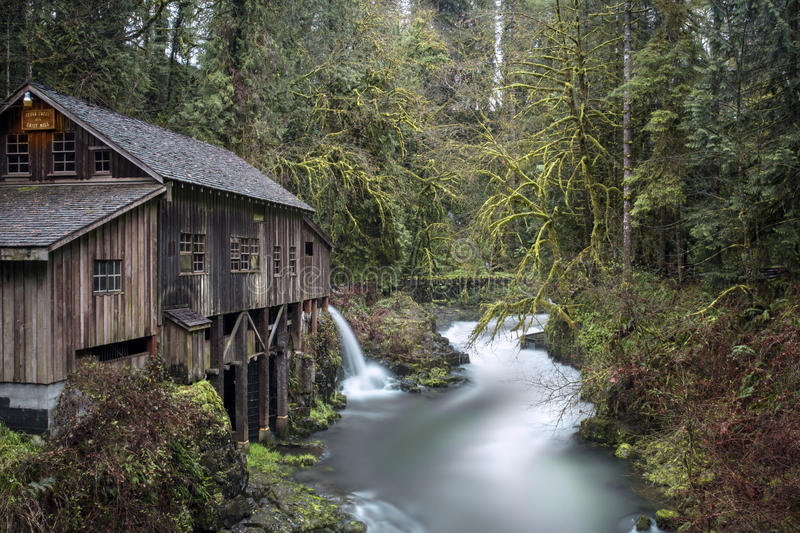 Cedar Creek Grist Mill, Washington State, USA. Water flowing into stream from Cedar Creek Grist Mill in Washington State, USA stock photo