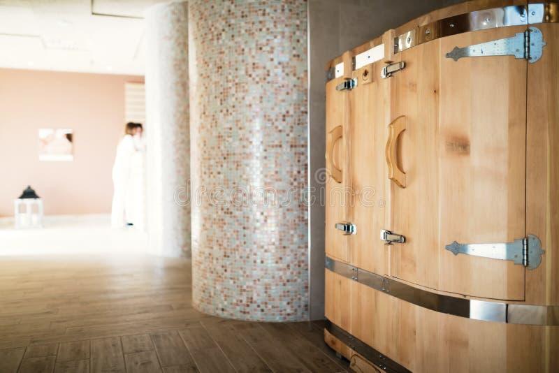 Cedar sauna in spa resort. Healthy cedar barrel sauna in spa resort stock photos