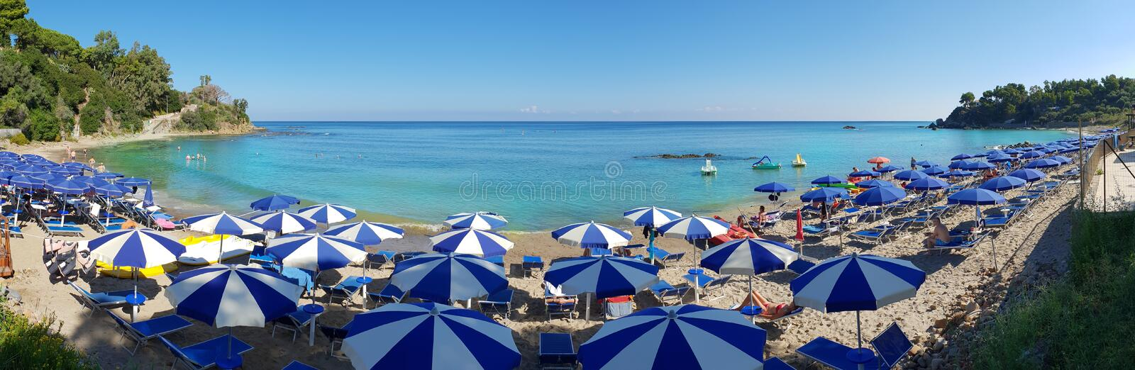 Cefalu beach in Sicily. Sicily, Italy - August 10, 2018: Panoramic view of a beach in Cefalu region, in summertime, Sicily island stock photography