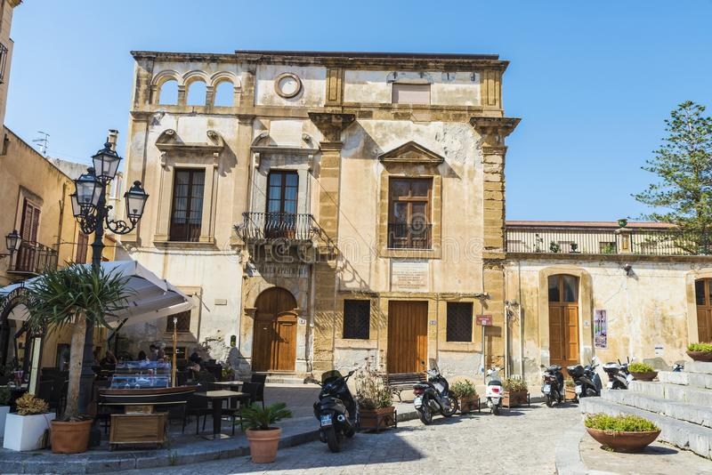 Street of the old town of Cefalu in Sicily, Italy stock photography