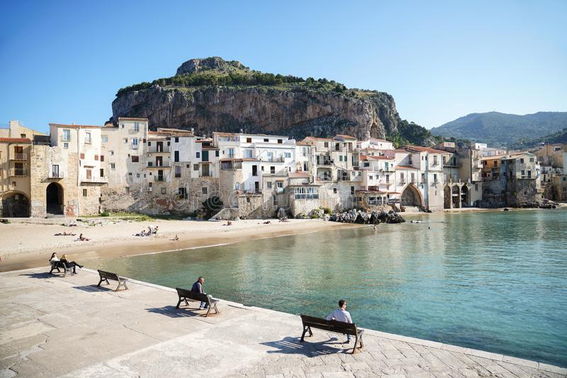 Cefalu, Italy - November 11, 2018: Harbor and houses near city beach in Sicilian city of Cefalu royalty free stock photography