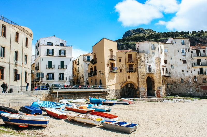 Cefalu, Sicily, Italy - Apr 7, 2019: Beautiful old harbor in small Sicilian city. Boats on a sandy beach. Traditional houses, stock image