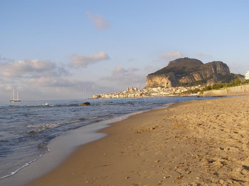 Cefalu Sicily Italy City View With Chiesa di Cefalu And Entire City From Beach. Cefalu Sicily Italy view from the city beach with Cefalu Rock and Cefalu Cathedra stock image