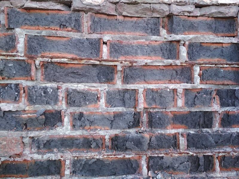 cegła uszkadzająca stara ściana Grunge szarość tło zdjęcie royalty free