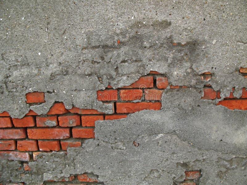 cegły cementują z odkrywczej ściany obraz stock