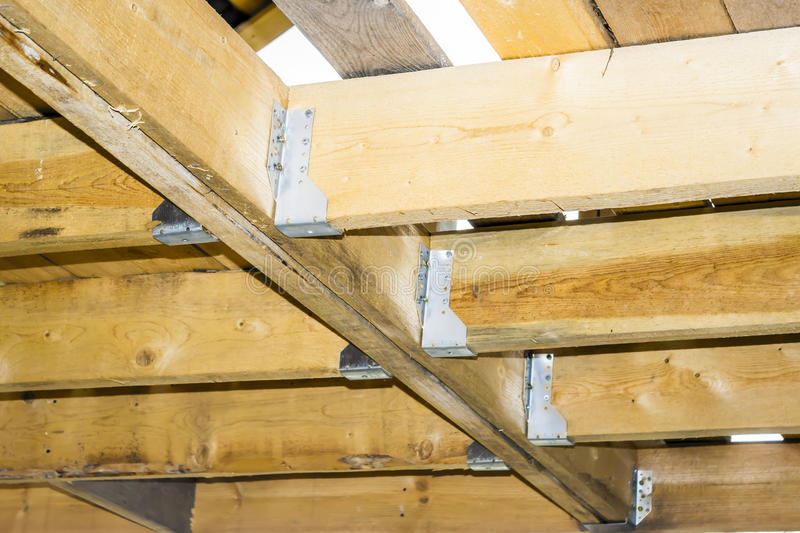 Ceiling beams - floors in a wooden frame house, metal fasteners. Construction technology royalty free stock photography