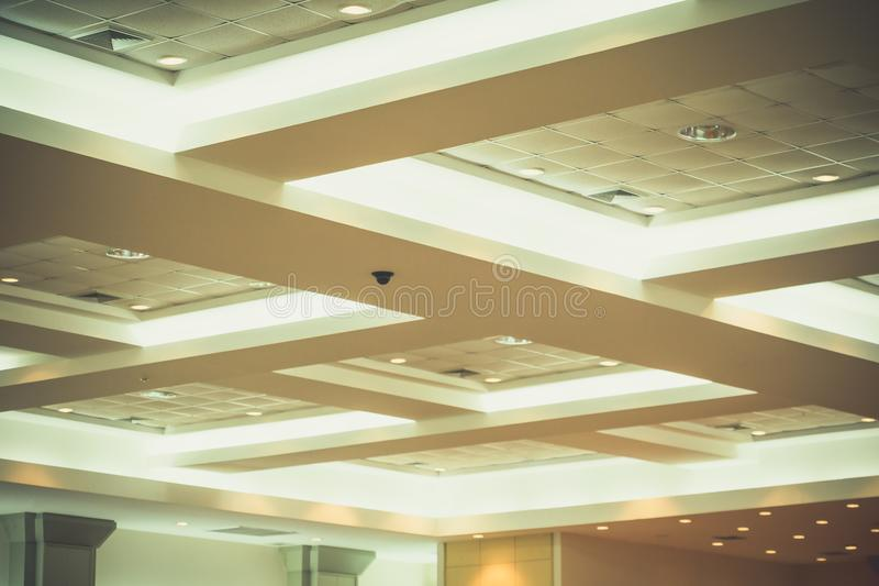 Ceiling of business interior office building and light neon. vintage style tone with copy space add text royalty free stock image