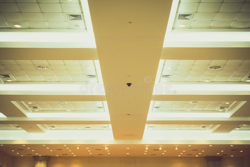 Ceiling of business interior office building and light neon. vintage style tone with copy space add text.  royalty free stock photography
