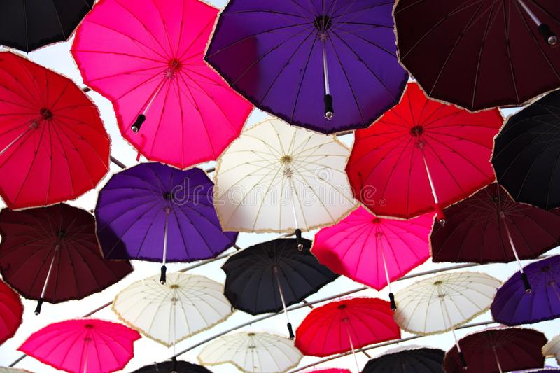 Colorful umbrellas. Ceiling with colorful umbrellas.ceiling with colorful umbrellas hanger hanging colored rain protection sun closing shadow canopy visuals wire stock photo