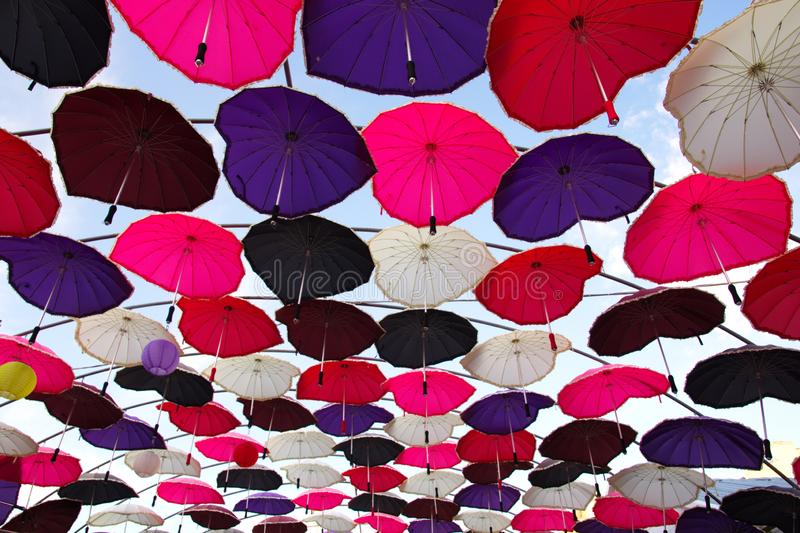 Colorful umbrellas. Ceiling with colorful umbrellas.ceiling with colorful umbrellas hanger hanging colored rain protection sun closing shadow canopy visuals wire stock photography
