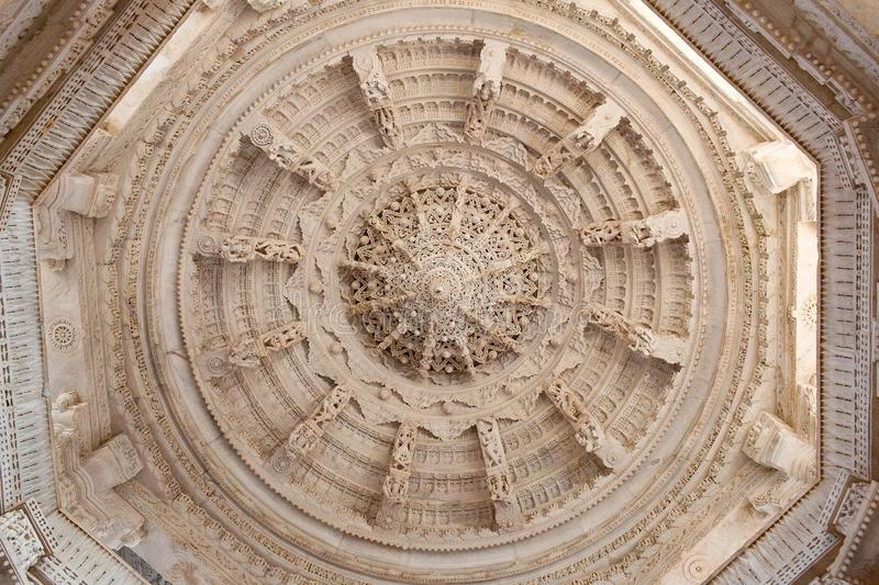 Ceiling decoration in ancient Ranakpur Jain temple in Rajasthan, India. Ceiling decoration with dancing Apsaras and Surasundaris in famous ancient Adinath Jain royalty free stock photos